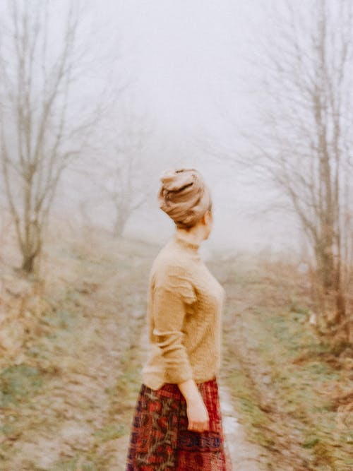 Photography of Woman Standing Near Outdoor