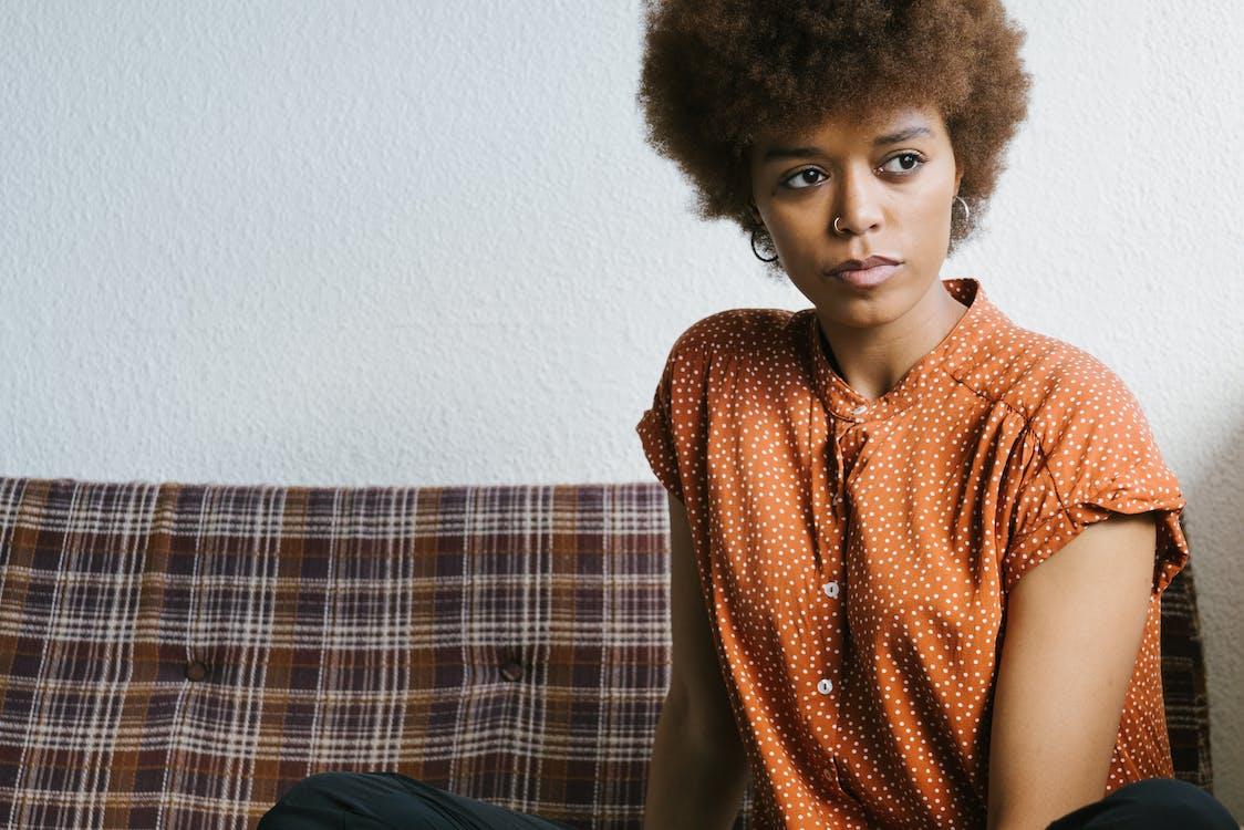 Photo Of Woman Wearing Orange Top