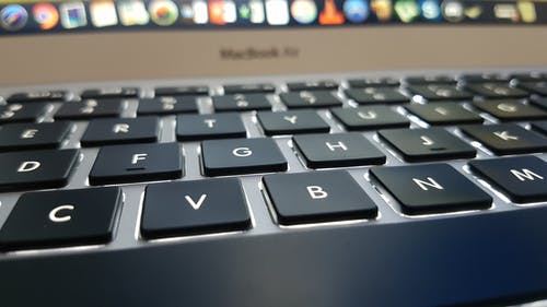 Selective Focus Photography of Turned-on Macbook Air