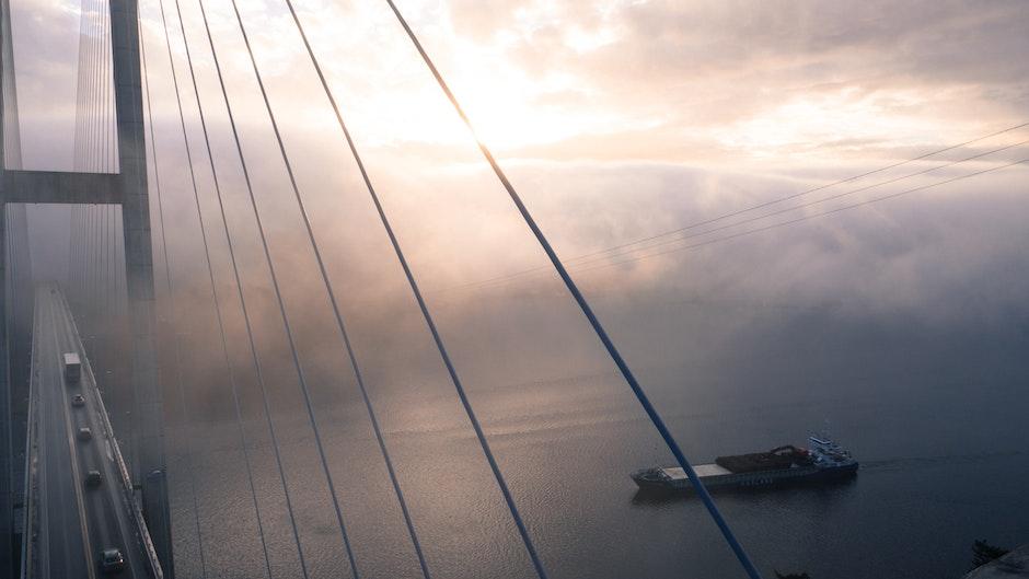 Sailboat on Sea Against Dramatic Sky