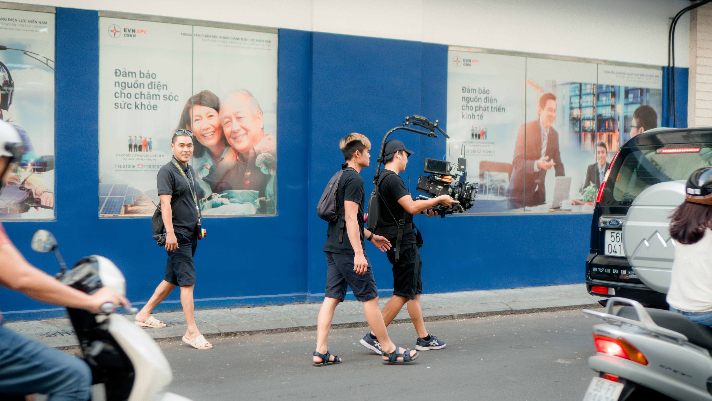 Photo Of Camera Crew Walking On Road