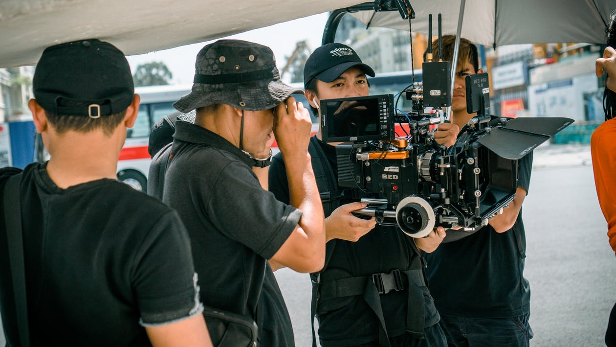 Photo Of Camera Crew Standing Near Each Other