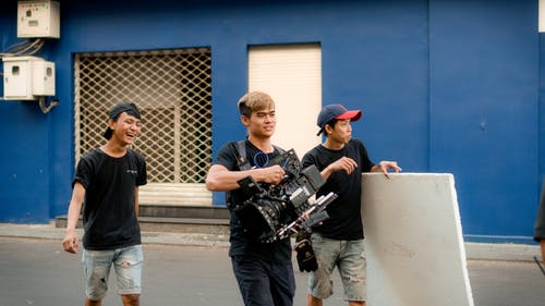 Photo Of Camera Crew Walking On Road