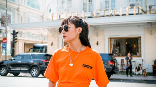 Photo Of Woman Wearing Orange Shirt