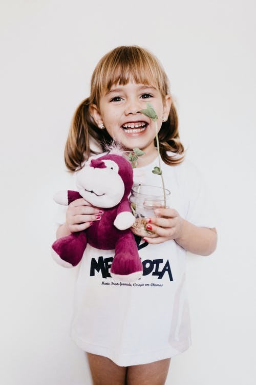 Photo Of Child Holding Stuffed Toy
