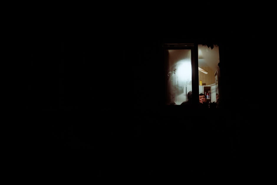 People inside a room with black background