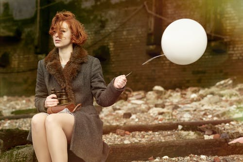 Woman Holding White Balloon