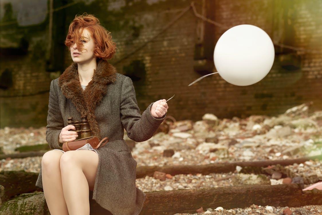 Woman Holding White Balloon