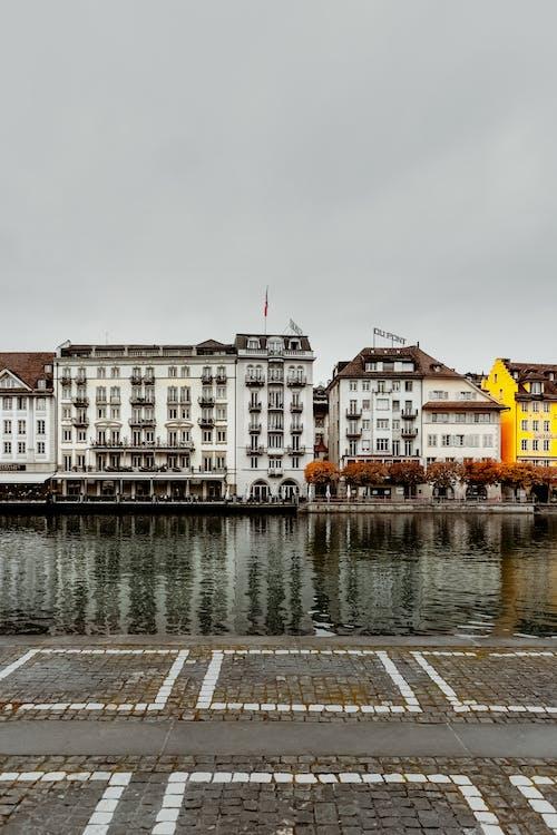 White Concrete Buildings Infront Of River