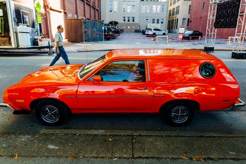 Red Station Wagon Parked on Road
