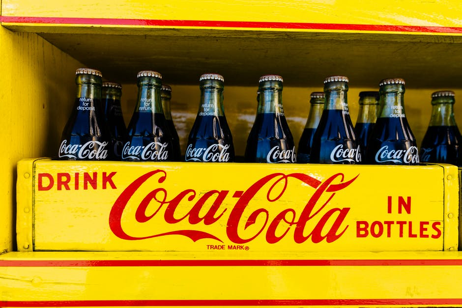 Coca cola bottles in yellow crate