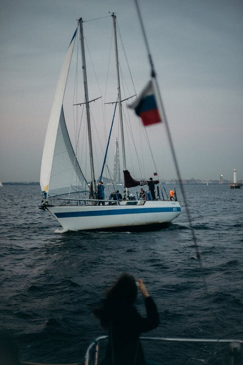 Photo of People on Sailboat