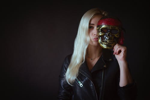 Photo of Woman Holding Skull Mask