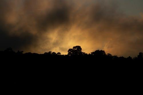 Základová fotografie zdarma na téma odpoledne, silueta, temné mraky