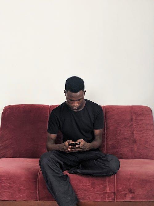 Kostnadsfri bild av 20-25 år gammal, 20-25 år gammal man, afrikansk man, afroamerikansk man