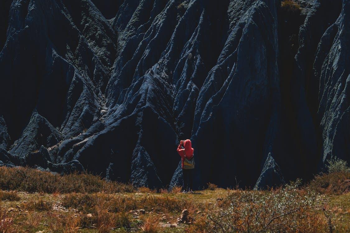 Person Taking Photo of a Mountain