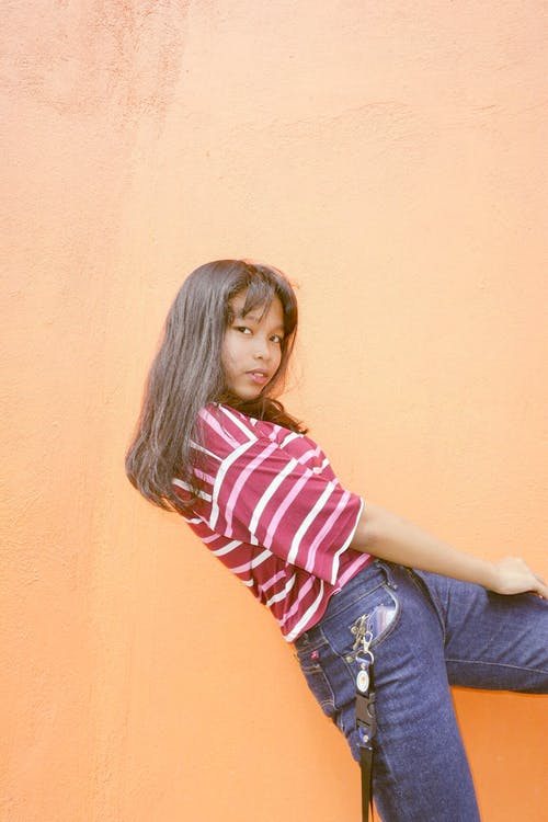 Girl in White and Pink Striped Top and Blue Jeans