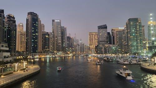 Foto d'estoc gratuïta de canal, capvespre, dubai, llums de la ciutat