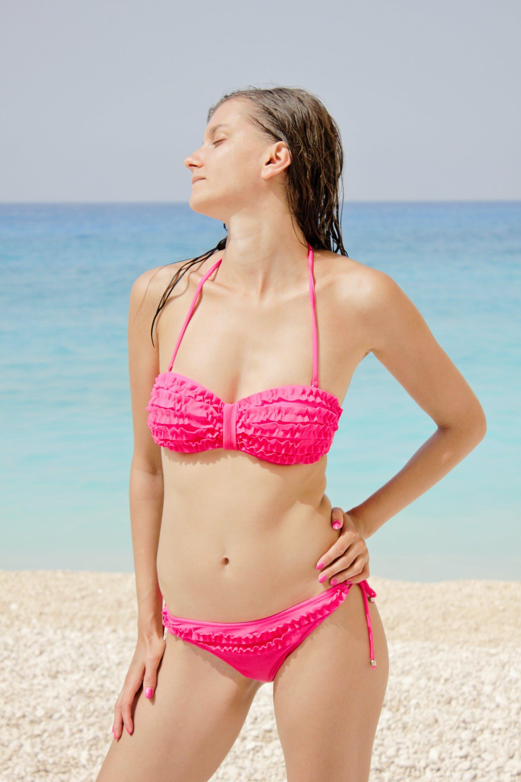 Woman in Pink Bikini Near Body of Water