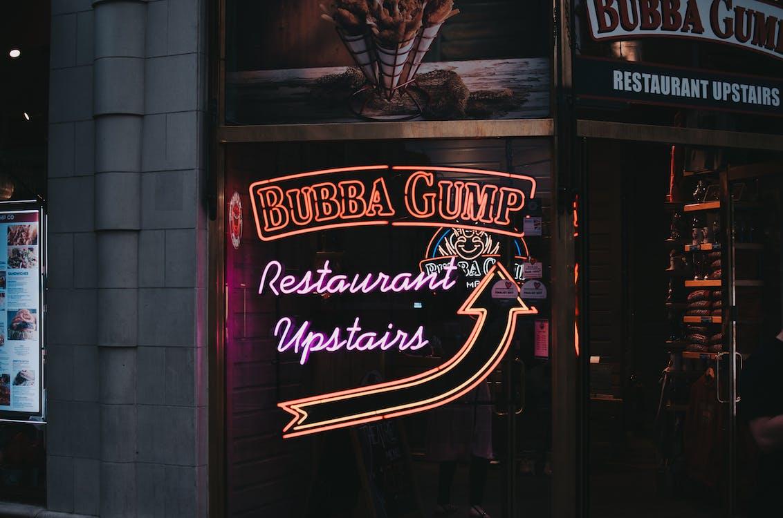 Illuminated Neon Sign Outside A Bar