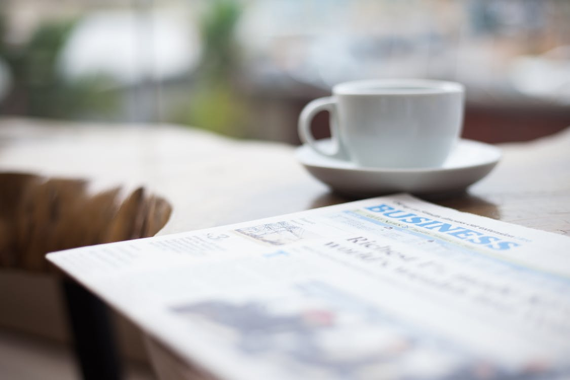 Selective Focus Photography of Business Newspaper
