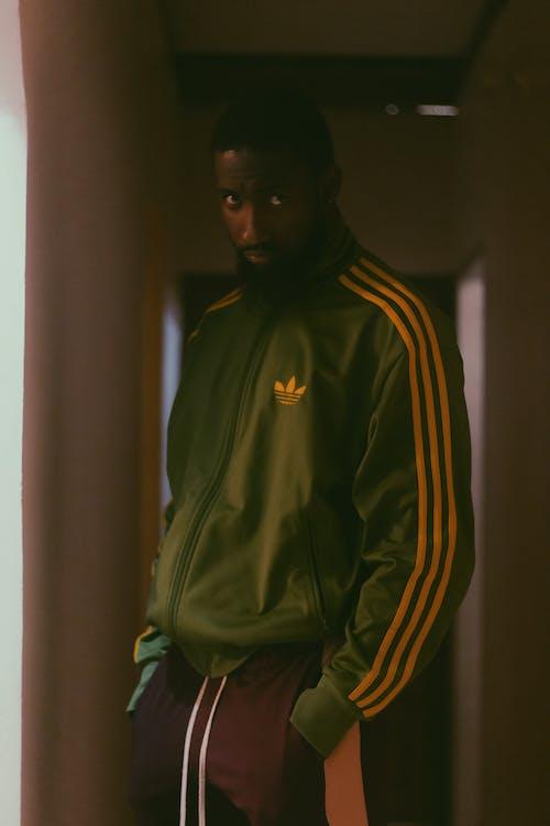Man Wearing Green Adidas Jacket