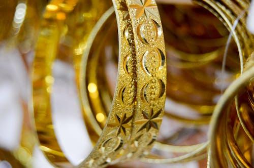 Free stock photo of bangels, golden bangels, golden jewelry