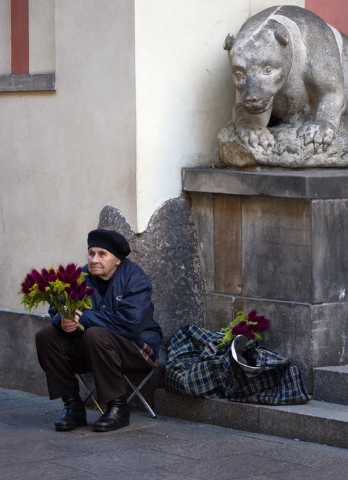 Old Woman Sitting on the Corner