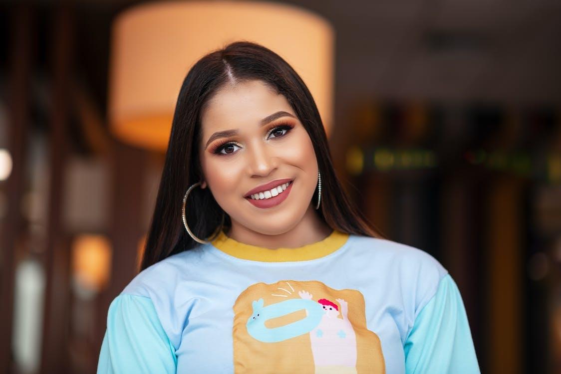 Selective Focus Portrait Photo of Smiling Woman