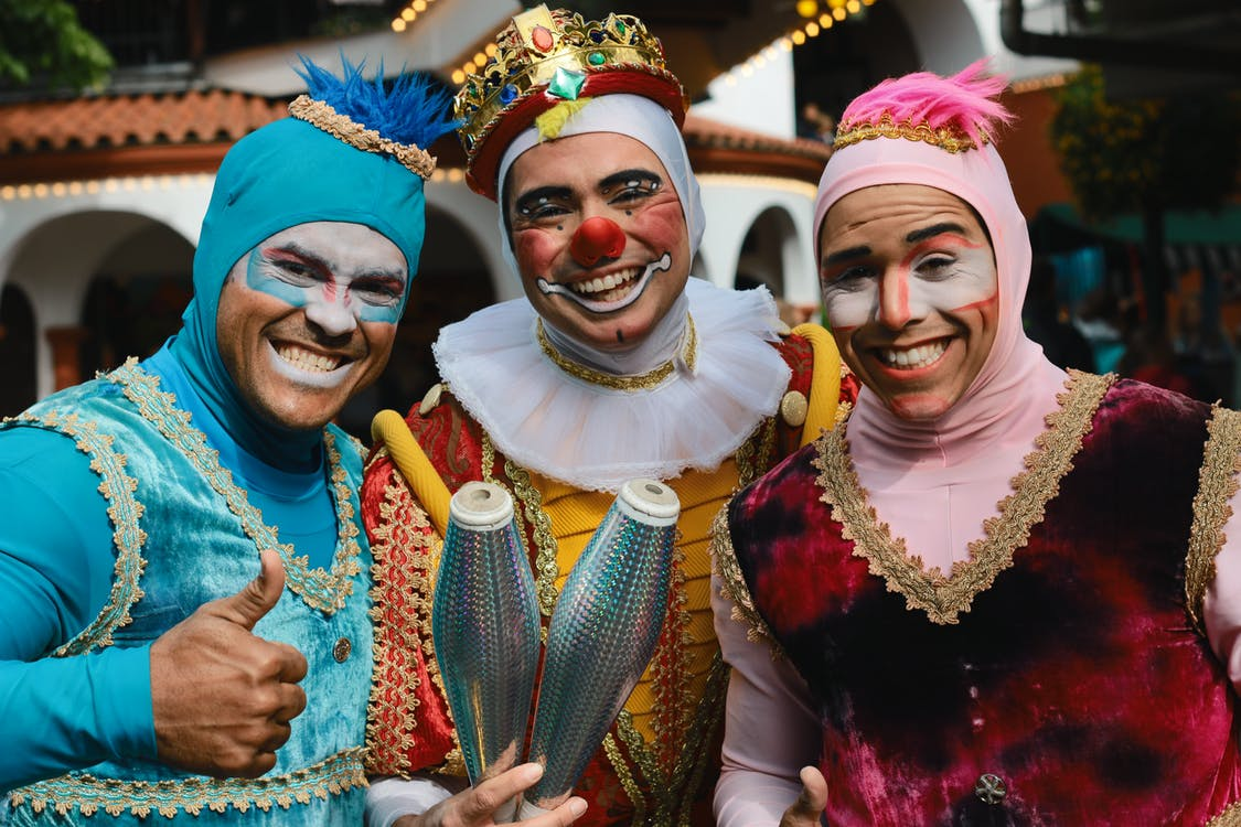 Three Jugglers With Smiling Faces