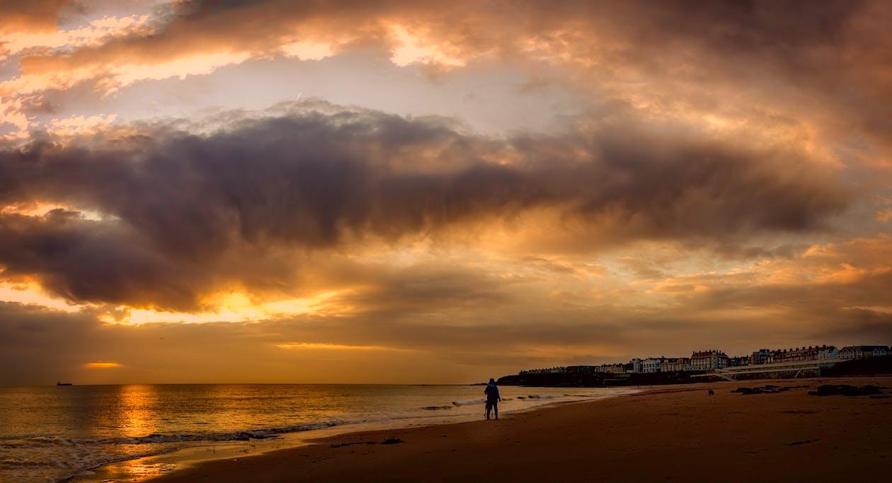 Person Standing on Seashore