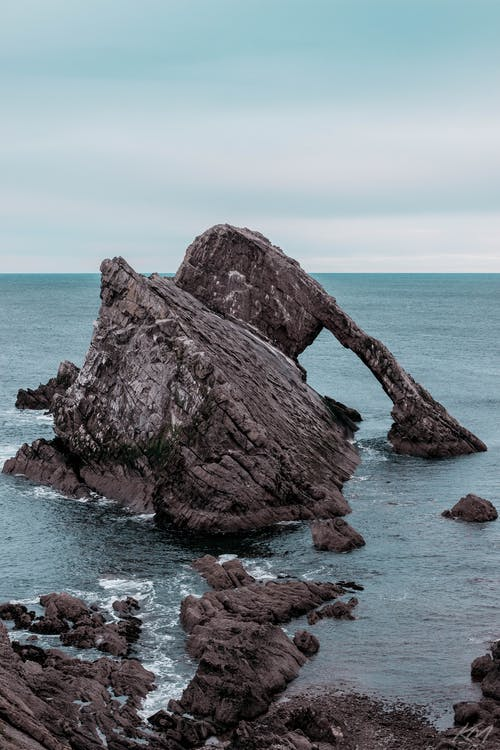 Brown Rock Formation on Sea
