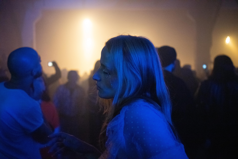 Woman Standing Among The Crowd