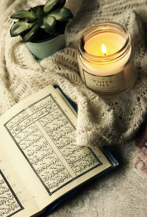 Photo Of Quran Beside Candle