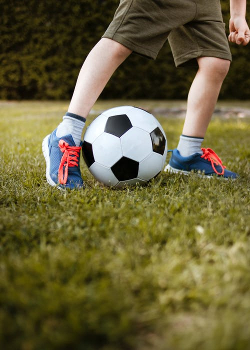 Boy Playing With Soccer Ball