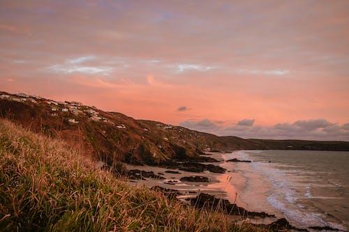 Foto d'estoc gratuïta de a l'aire lliure, alba, cel, costa oceànica