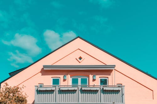 Pink and Gray House Under Blue Sky