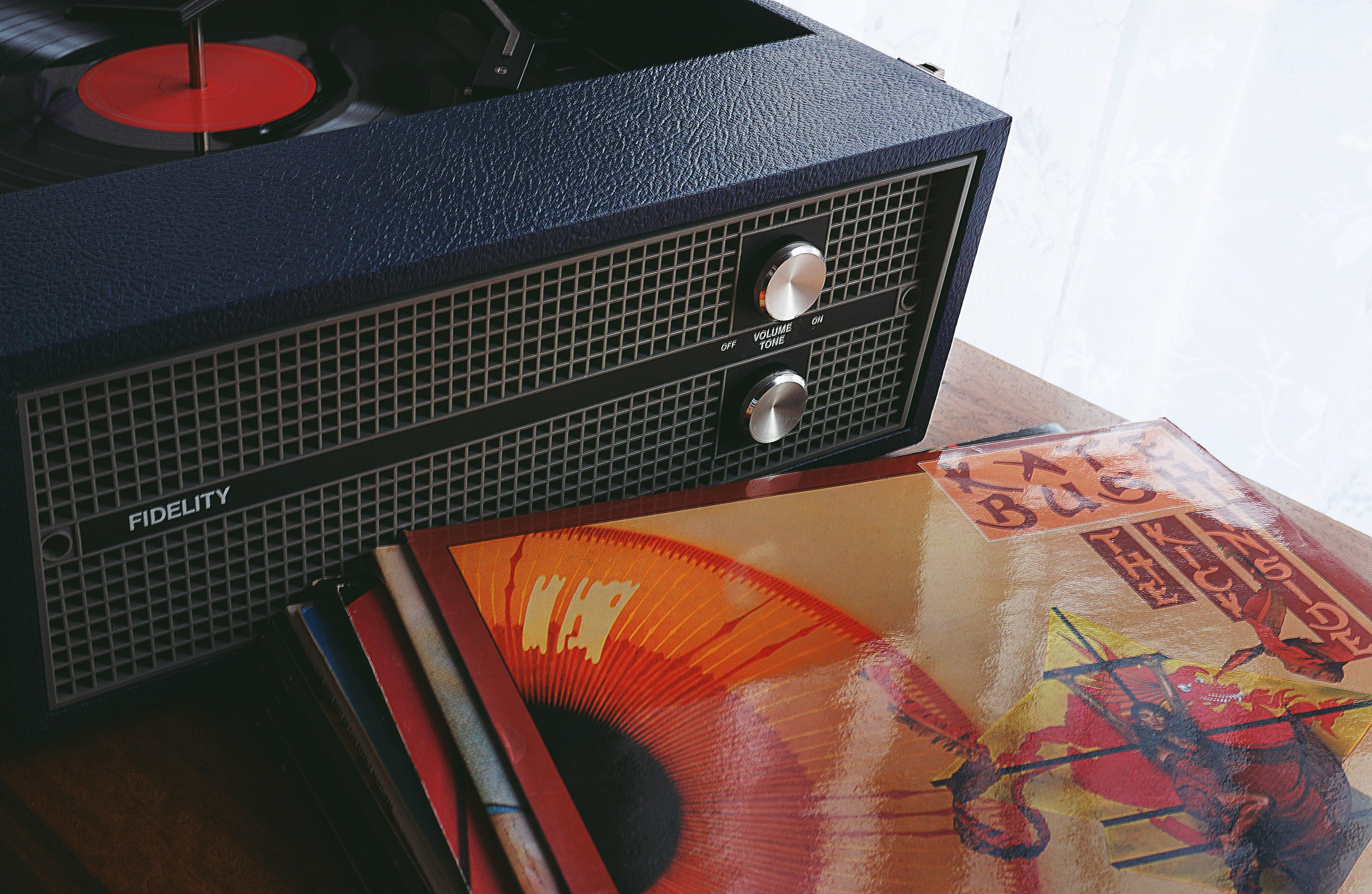 Black Speaker Beside Vinyl Sleeve