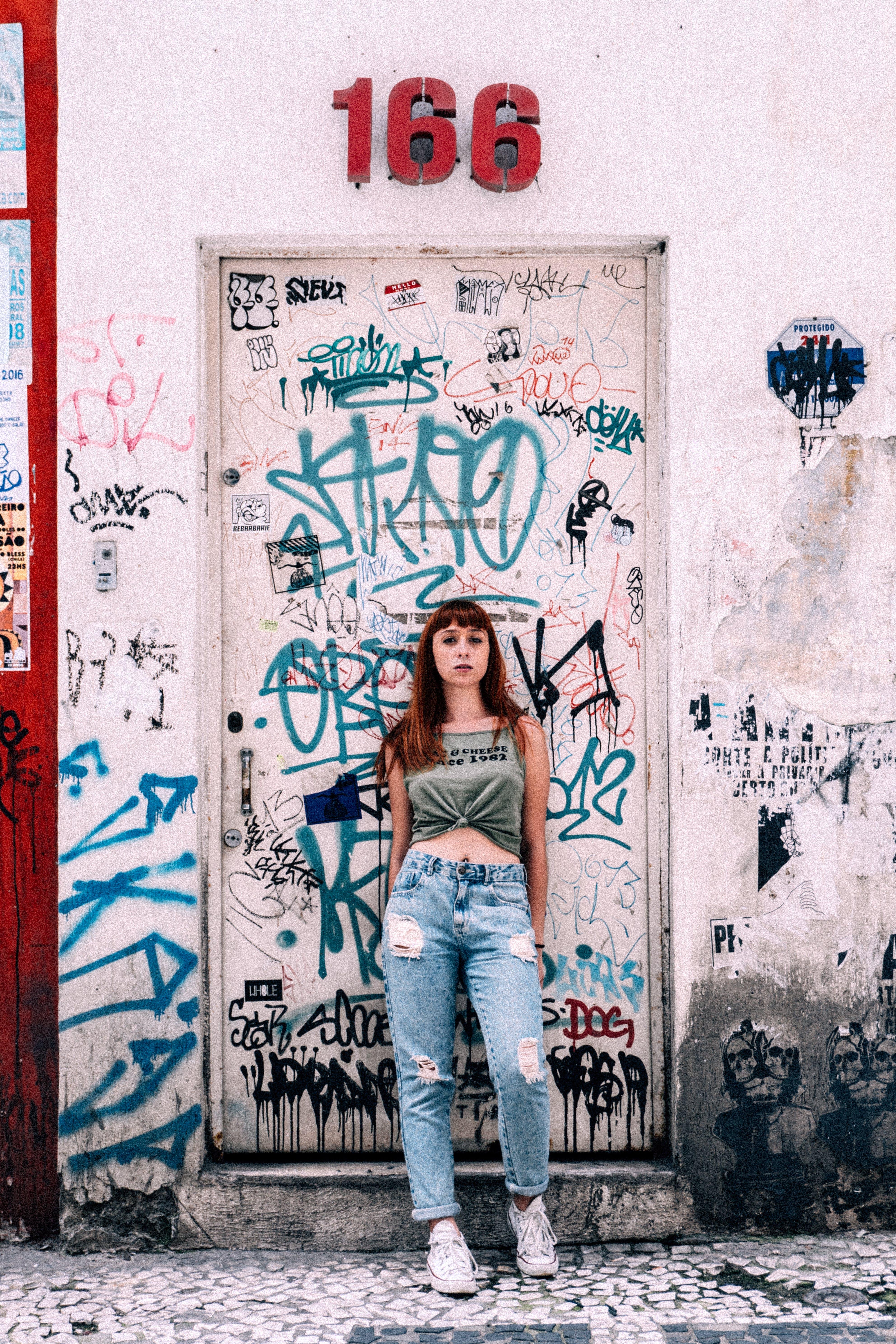 Woman Standing Near Graffiti Wall