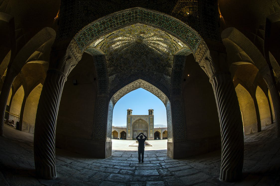 Fisheye Shot Of A Person InSide A Building With Columns And Ornate Ceiling