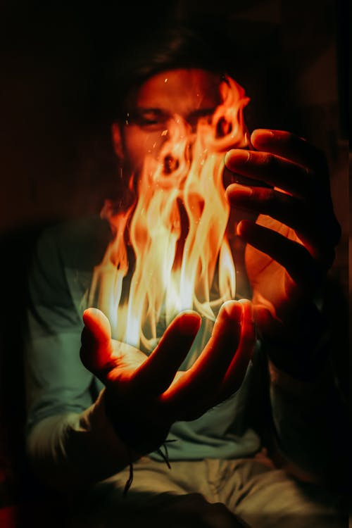 Free stock photo of comming, fire, from, hand