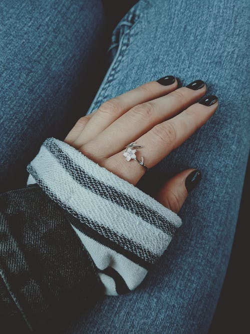 Silver Flower Ring On A Woman's Hand