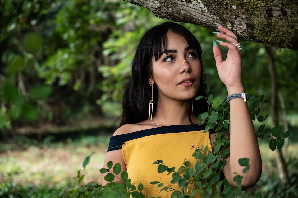 Portrait Photo of Woman Standing Under Tree