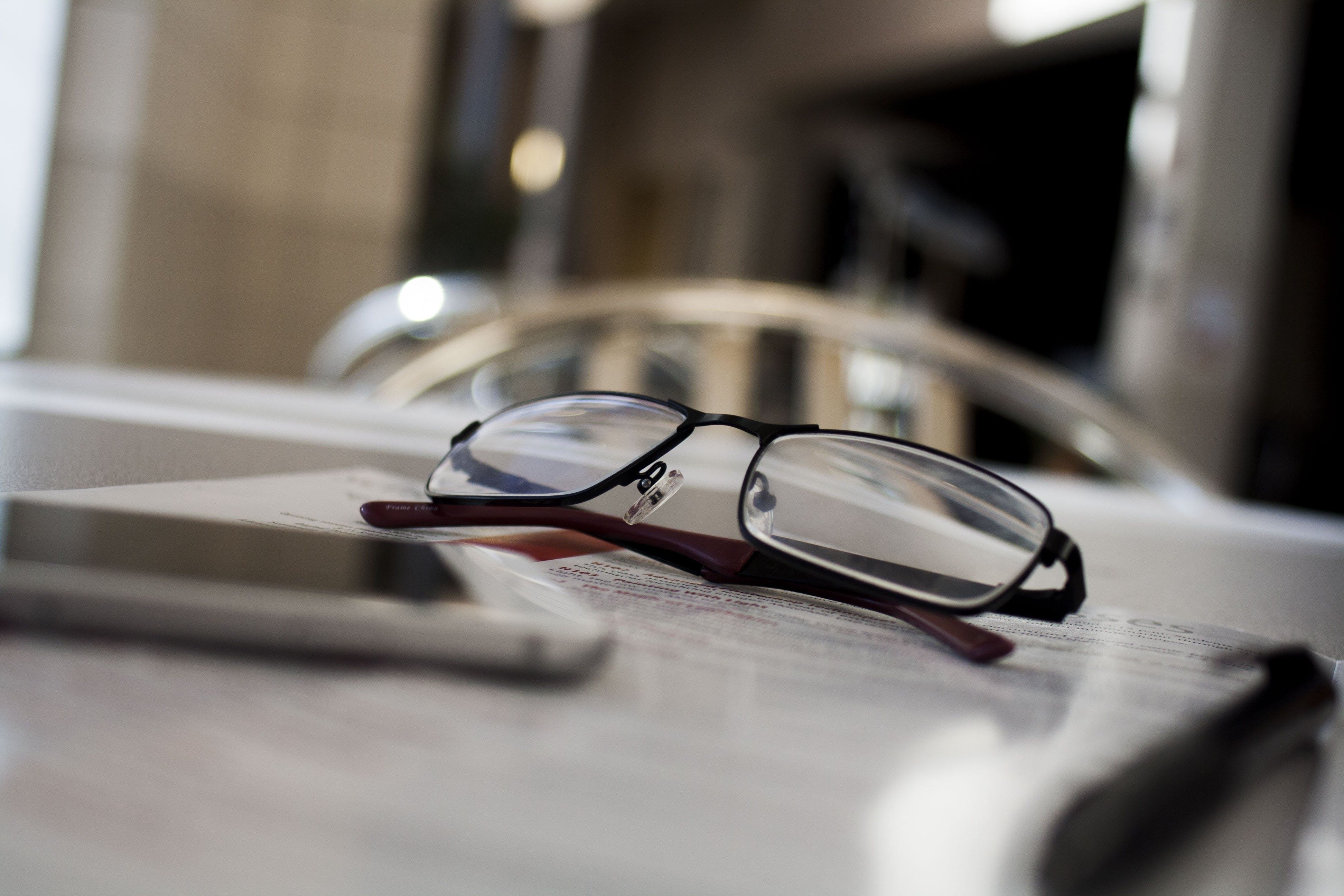 Free stock photo of pen, table, technology, glasses