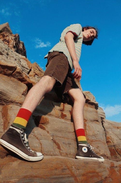Free stock photo of boy, colors, legs, rock