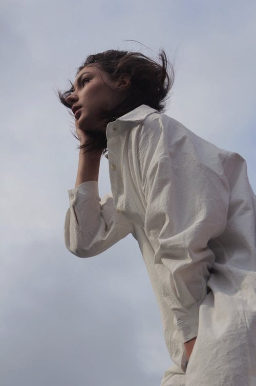 Low Angle Photo of Woman in White Dress Shirt Posing