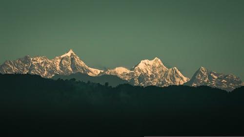 Kostnadsfri bild av bakgrund, berg, blågrön, filmiska