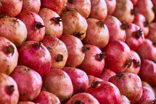 Close-up Photo of a Bunch of Pomegranates