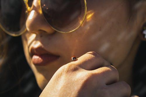 Ladybug on Woman's Hand