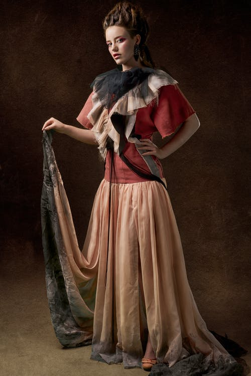 Woman In Brown And Red Long Dress